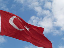 Turkish flag. Turkish official flag in Istambul, clouds Royalty Free Stock Images