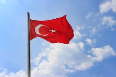 Turkish Flag On Blue Sky With Soft Clouds Background. Flag Of Turkey Against Sky On Summer Sunny Day.