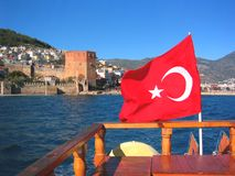 Turkish Flag over Alanya. A Turkish flag waves on a boat in the Alanya harbor Royalty Free Stock Images