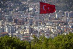 Turkish flag over the city. Alanya, Turkey. Wonderful country. At home from a height. Roofs of buildings.  royalty free stock images