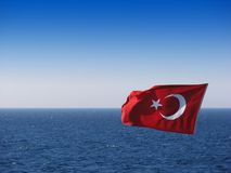 Turkish Flag Over Sea. Turkish flag waving over sea and sky Royalty Free Stock Images