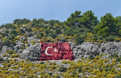Turkish flag painted in the mountain town of Finike. Turkey. Stock Photography