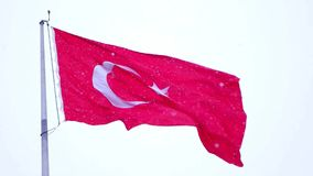 Turkish flag slow motion waving and it snows in Izmir Turkey stock footage