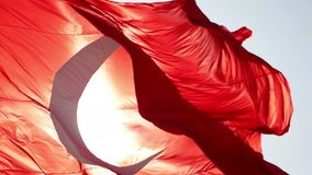Turkish flag slow motion waving. With sunny background stock footage