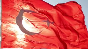 Turkish flag slow motion waving. With sunny background stock video