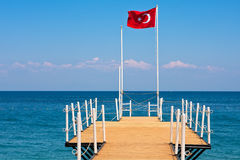 Turkish flag on small pier in Kemer, Turkey. Stock Images