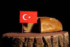 Turkish flag on a stump with bread.  Royalty Free Stock Image