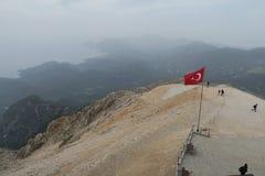 Turkish Flag at the Tahtali Dagi - Olympos - Mountain in Kemer, Turkey. Turkish Flag at the Top of the Tahtai Dagi - Olympos Mountain in Kemer with Olympos Beach stock image