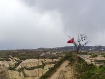 Turkish flag and wish tree on the observation deck in Cappadocia on a cloudy day royalty free stock photos