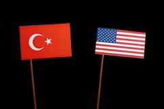 Turkish flag with USA flag on black. Background stock images