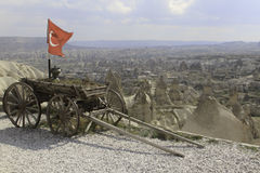 Turkish flag on a wagon and a rock desert. Turkish flag and a rock desert in Kappadokia Stock Photo
