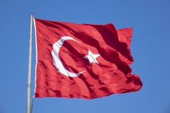 Turkish flag waving in blue sky, Ankara stock image