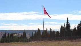 Turkish flag waving in the blue sky. On the Dardanelles throat stock video