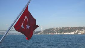 Turkish flag waving on a boat in Bosphorus strait, Istanbul, Turkey. Istanbul, Turkey - March 2019: Turkish flag waving on a boat in Bosphorus strait, Istanbul stock video footage