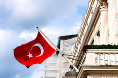 Turkish flag waving from the embassy balcony in London exterior view front entrance outdoors Stock Photography