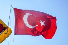 Turkish flag waving in the sky stock image