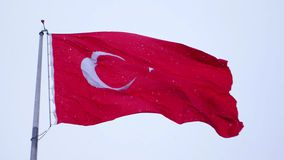 Turkish flag waving and it snows in Izmir Turkey stock video footage