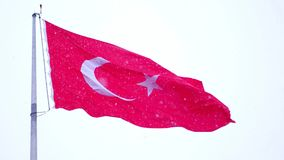 Turkish flag waving and it snows in Izmir Turkey. Turkish flag waving and it snows stock video