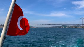 Turkish flag waving on the stern of an Istanbul Ship is Floating. In Bosphorus stock footage