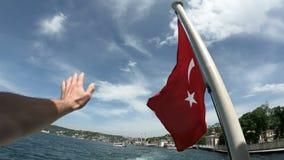 Turkish flag waving on the stern of an Istanbul Ship is Floating, Tukriye Bye bye. Turkish flag waving on the stern of an Istanbul Ship is Floating in Bosphorus stock video footage
