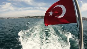 Turkish flag waving on the stern of an Istanbul Ship is Floating. In Bosphorus stock video footage