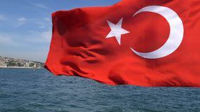 Turkish flag waving on the stern of an Istanbul Ship is Floating. In Bosphorus stock video