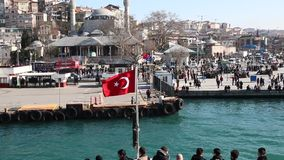 Turkish flag waving on the stern of an Istanbul Ship is Floating stock video footage