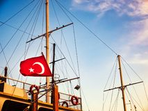 Turkish flag is waving on the top of nautical vessel stock photo