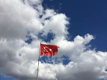 Turkish flag. Waving under the blue and cloudy sky Stock Images
