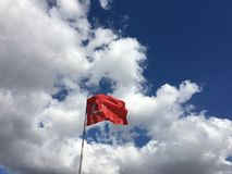 Turkish flag. Waving under the blue and cloudy sky Stock Photo