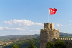 Turkish flag waving in the wind at the Boyabat castle royalty free stock photos