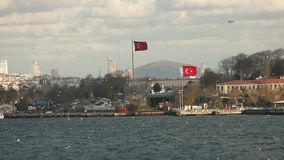 Large Turkish flag on the shores of the Bosphorus, Istanbul. Turkish flag waving in the wind on the shores of the stock video footage