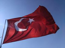 Turkish Flag. A flag in the wind develops against the blue sky. Stock Images