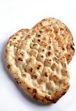 Turkish flat bread. Two loaves of traditional Turkish flat bread on a white background Royalty Free Stock Image