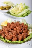 Turkish Food Cig Kofte with lemon, lettuce and parsley on silver plate.  stock images