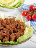 Turkish Food Cig Kofte with lemon, lettuce and parsley on silver plate.  royalty free stock photo