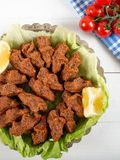 Turkish Food Cig Kofte with lemon, lettuce and parsley on silver plate.  stock photography