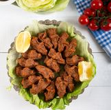 Turkish Food Cig Kofte with lemon, lettuce and parsley on silver plate.  stock image
