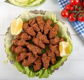 Turkish Food Cig Kofte with lemon, lettuce and parsley. On silver plate stock images