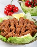 Turkish Food Cig Kofte with lemon, lettuce and parsley on silver plate.  stock photos