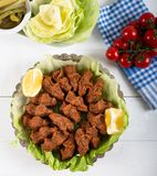 Turkish Food Cig Kofte with lemon, lettuce and parsley. On silver plate stock photos