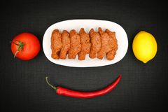 Turkish Food Cig Kofte. Turkish Traditional Food Cig Kofte on the Table royalty free stock photo