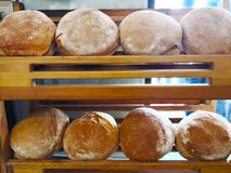 The Turkish food concept. The round Turkish bread prepared for s. Ale, that are arranged on the wooden shelves. Close up, Selective focus and copy space Stock Photos