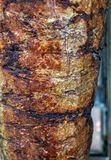 Turkish Food Doner Kebab - arabic shawarma. Istanbul street foodl Doner Kebab made of meat cooked on a vertical rotisserie. traditional Turkish dish that is Stock Photo