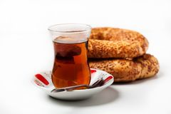 Turkish food: simit bread and cup of tea. In traditional glass Royalty Free Stock Photography