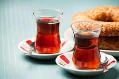 Turkish food: simit bread and cup of tea. In traditional glass Stock Photography