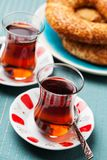 Turkish food: simit bread and cup of tea. In traditional glass Stock Images
