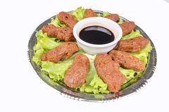 Turkish foods; cig kofte. Traditional delicious Turkish foods; bulgur salad, cig kofte royalty free stock image