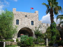 Turkish fortress. Turkish ancient fortress. Green trees and turkish flag. sunny day and blue sky Stock Photography