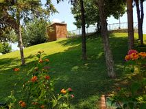Turkish garden with beautiful flowers and tropical sun. Antalya-Turkey - July 01, 2017: Green tropical back yard situated inside a luxury hotel from Turkey near stock images